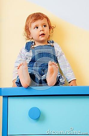 Kid sitting on furniture