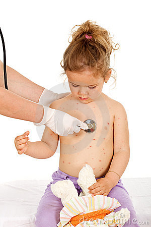 Kid with skin rash being examined at the physician