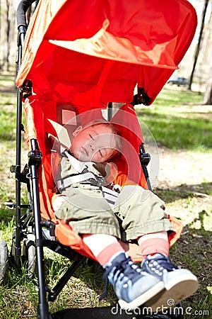 Kid sleeps in the buggy