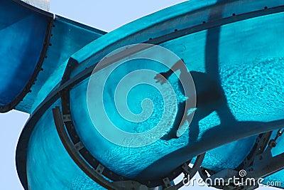Kid sliding a blue Waterslide Stock Photo