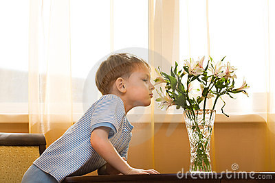 Kid smells a bouquet