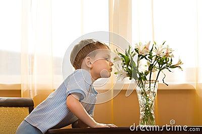 Kid smells a bouquet
