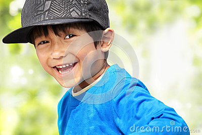 Kid smiling to the camera