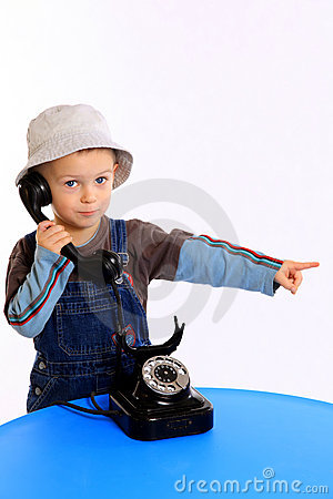 Kid speaking on the telephone