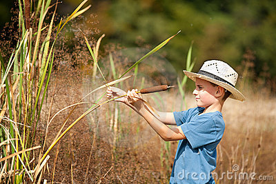 Kid with straw hat playing