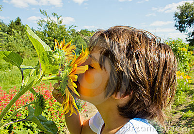 Kid with sunflower