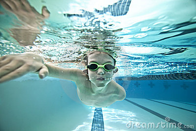 Kid swimming laps