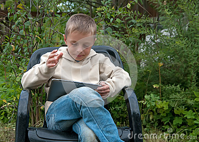 Kid with tablet pc.