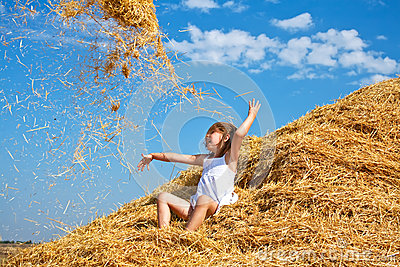 Kid throwing hay