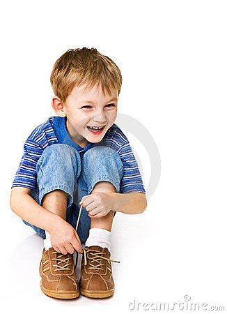 Kid try to tie shoelaces