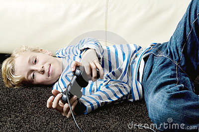 Kid using playstation controls at home.