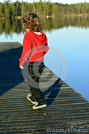Kid  walking on the bridge