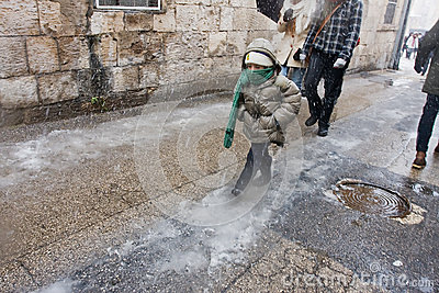 Kid walking in Jerusalem snowfall Editorial Photo
