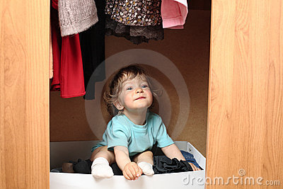 Kid in wardrobe