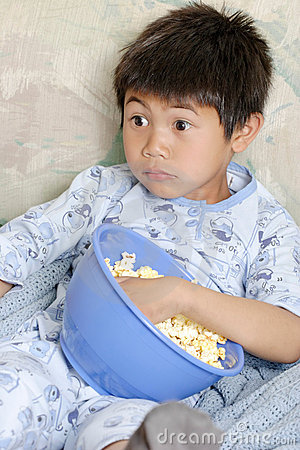 Free Kid Watching A Scary Movie Stock Photos - 547573