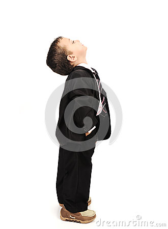 Kid wearing suit looking up