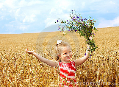 Kid in wheat field.