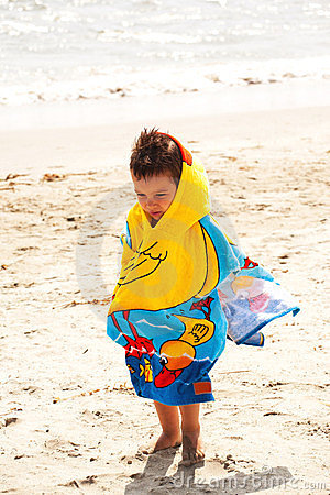Kid wrapped in towel