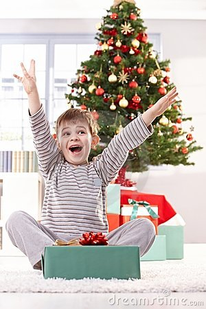 Kid yelling happily at christmas gift