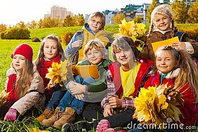 Kids on autumn lawn
