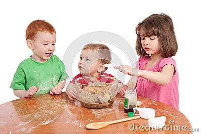 Kids baking cake