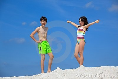Kids in bathing suits on beach