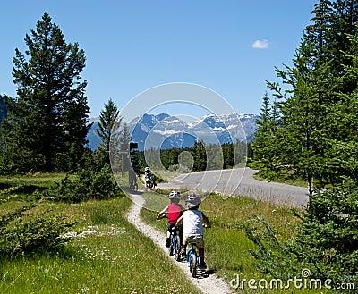 Kids biking outdoors