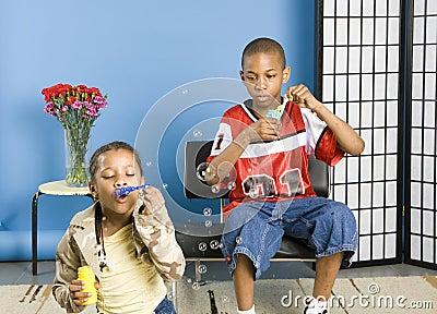 Kids blowing bubbles