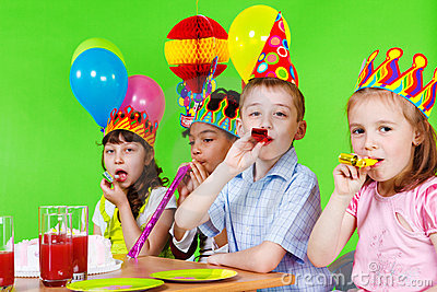 Kids blowing into party horns