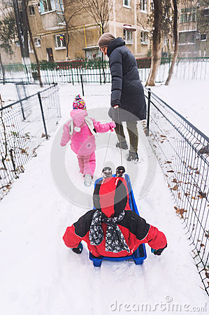 Kids on bob sledge