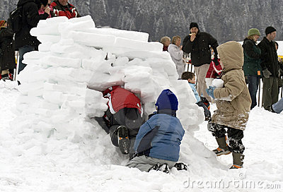 Kids building an igloo (snow house)