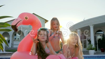 Kids Celebrities In Swimsuit On Summer Vacation, Little Girls Lie On Inflatable Pink Flamingo Near Pool, Spoiled Rich Stock Footage - Video of people, pink: 96841088
