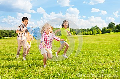 Kids chasing butterfly