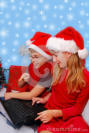 Kids choosing christmas gifts in internet