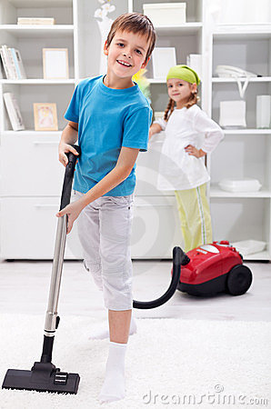 Free Kids Cleaning The Room - Using A Vacuum Cleaner Royalty Free Stock Photo - 23385465