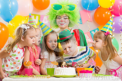Kids with clown celebrating birthday party
