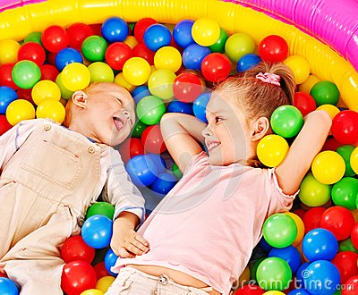 Kids in colored ball.