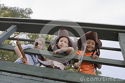 Kids In Costumes Looking Through Wooden Railings