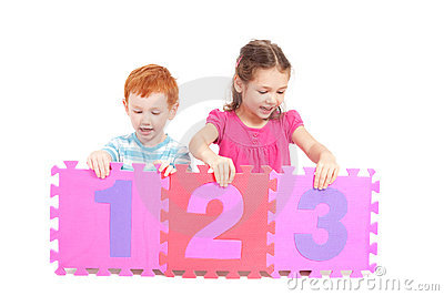 Kids counting 123 with number tiles