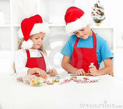 Kids decorating christmas cookies