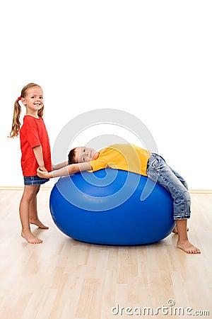 Kids doing gymnastic exercises