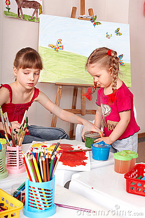 Kids drawing colour pencil in play room.