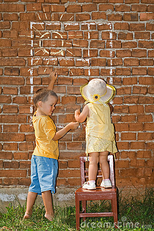 Kids drawing sunny window to a brick wall