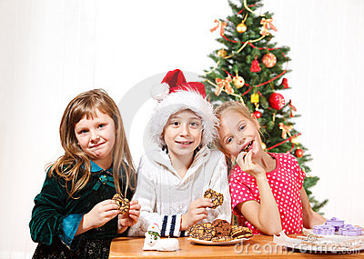 Kids eating  cookies