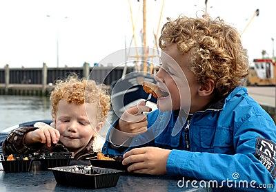 Kids eating fish