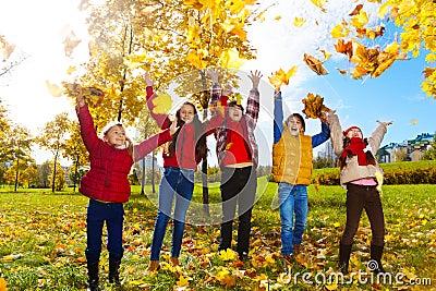 Kids enjoying autumn maple park