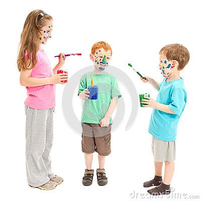 Kids face painting each other with paint