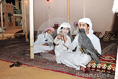 Kids with Falcon in Abu Dhabi International Hunting and Equestrian Exhibition 2013 Editorial Photography