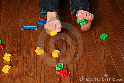 Kids feet pickup up blocks