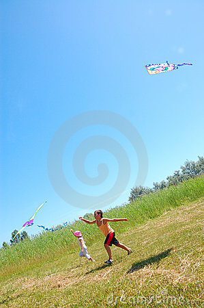 Kids flying kites high up